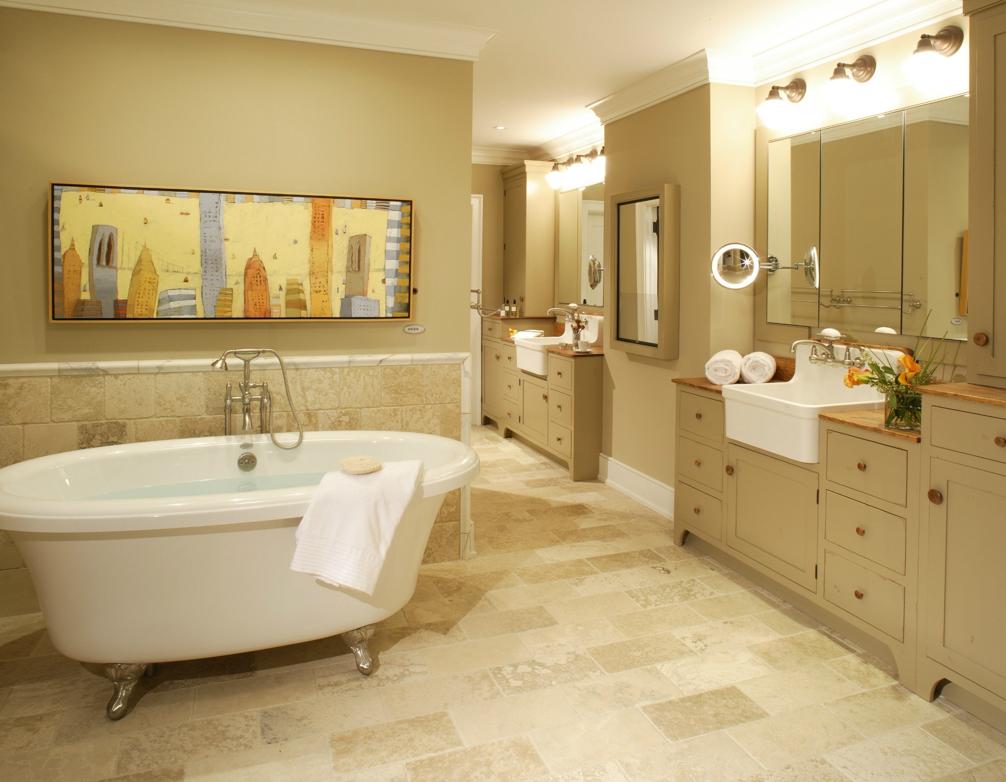 master bath with his and hers sinks and clawfoot bathtub