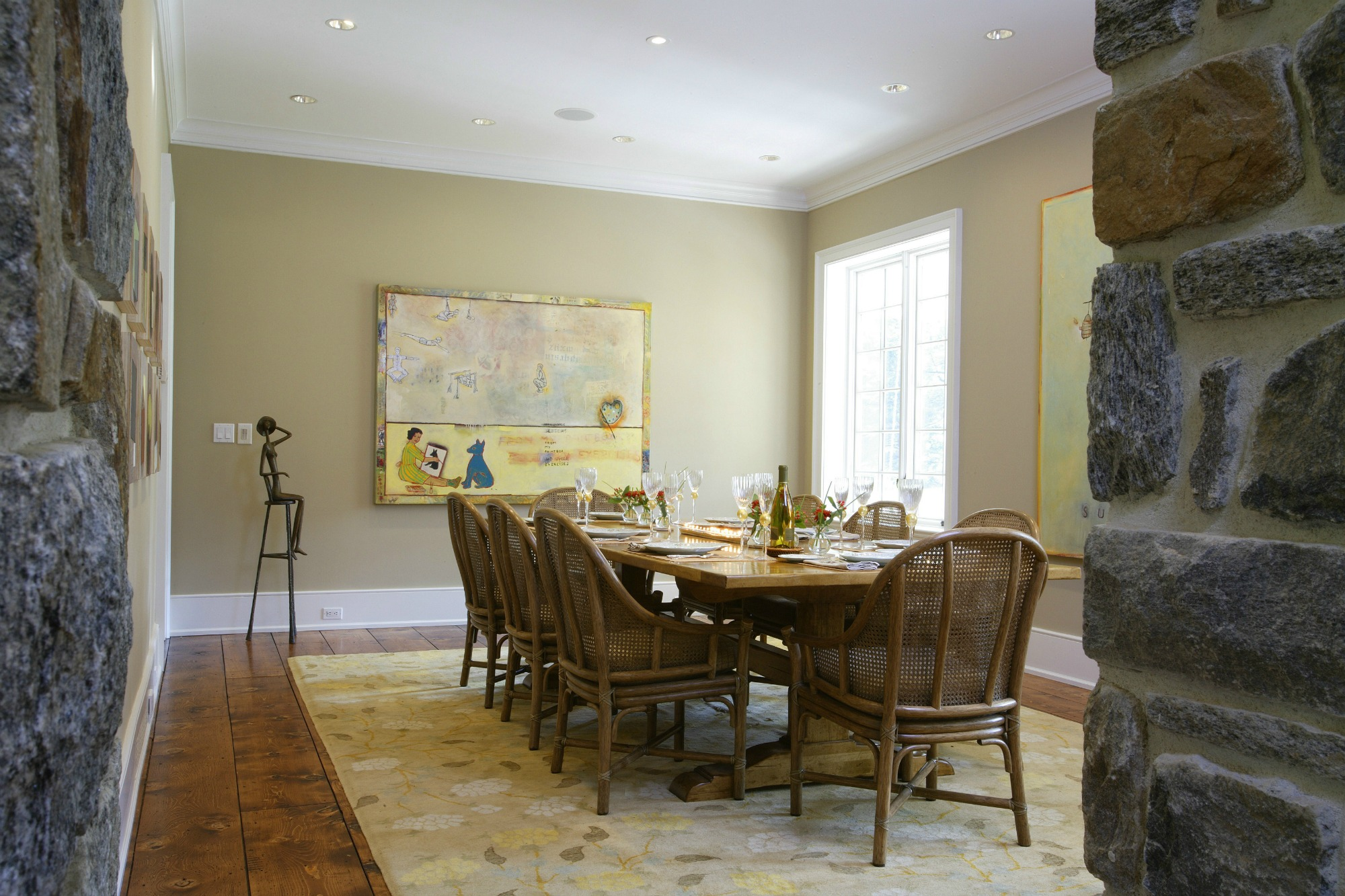 simple dining room with accented stone wall